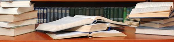 Books on desk photo